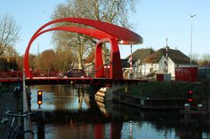 "Rode Brug, Holland -The Rode Burg, meaning ""The Red Bridge"", is very distinctive bridge with a bizarre shape and even more bizarre speculative symbolism. Some suggest that the bridge's shape reminds a woman's pelvic area with straddle legs, and combined with its red color – they are symbolize the nearby red light district in Utrecht, where prostitutes are found on houseboats."