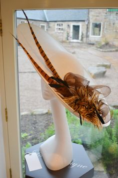 Ivory Sinamay Hat with Couture feather and Quills.