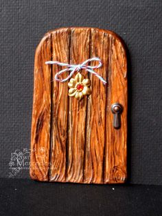 Fairy Door made from paperclay using a wood texture stamp.