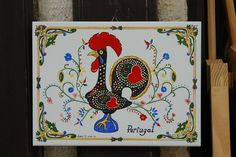 "O galo de Barcelos, or ""the Rooster of Barcelos"" is the symbol of Portugal. It's a popular keepsake for tourists"