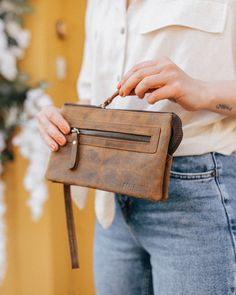 Our pretty leather clutch bag is a must-have accessory for this season. We've thoughtfully designed this clutch bag for those who like to keep their essentials compact. Leather Hobo Bags, Leather Saddle Bags, Leather Bags Handmade, Women's Handbags, Womens Purses, Distressed Leather, Leather Accessories, Light In The Dark, Compact
