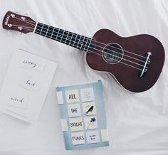 #Repost @perfectionpages  #nwpjan17 | book and instrument my uke ofc :) i love ukulele and i hope that i keep playing it for a long time!! today i wanted asoue episode one and then procrastinated all day oh well also i ordered a fidget cube online and it arrived today and it's so useful yay   q // do you play any instruments? a // ukulele right now and i used to play guitar piano and recorder (ew). singing is my main musicality thing