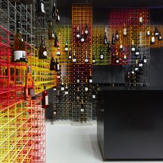 """Wine bottles are displayed in rainbow-coloured cages in this wine shop in Stuttgart, Germany, by local studio Furch Gestaltung + Produktion…""  (via Weinhandlung Kreis wine shop interior by Furch Gestaltung Production)"