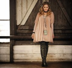 I dig this, minus the necklace. Babydoll dress and boots #plus #size