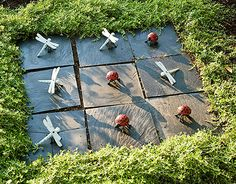 Make an outdoor Tic Tac Toe Game by using tiles and some yard decorations as fun decor. Cute idea to make for kids (family time) or grandkids to play in the yard.