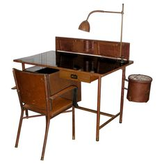 Fantastic desk by Jacques Adnet | From a unique collection of antique and modern desks and writing tables at http://www.1stdibs.com/furniture/tables/desks-writing-tables/