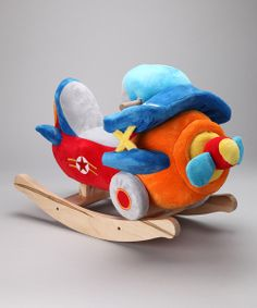 Soar high in the sky with this plush bi-plane rocker. Buttons on the front instrument panel play four original songs, making this high flyer the perfect all-in-one playmate.  Weight capacity: 80 lbs.Approx. 12'' W x 17'' H x 24'' D12 lbs.Fabric / wood