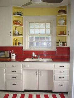 Love the red backsplash with yellow.