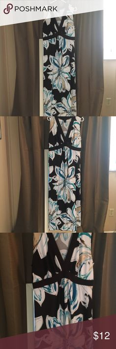 A lovely Summer Maxi Beautiful Floral Maxi.  I love to wear one with wedges in the summer. I also pair with flats for a summer lunch. It's easy, breezy style! Enfocus Woman Dresses Maxi