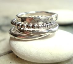 textured silver stackable rings.