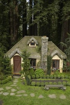 "Adorable Cottage nestled in the forest....what's not to love? When I picture my ""happy place,"" this is what it looks like."