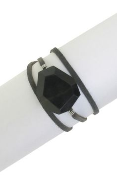 "A bold faceted black stone captivates the attention on this grey suede strip leather bracelet.   - Freeform black jasper stone on leather wrap bracelet, Self tie closure, Approx. 26"" length"