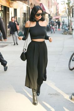 Kylie Jenner wears a black halter top and culottes in NYC.