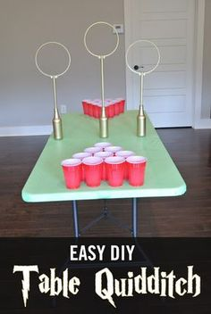 Easy DIY Quidditch Game.  Table Quidditch can be played as Quidditch Beer pong or as a fun game with kids on a points system.  Easy to make and very fun for Harry Potter fans of all ages!  Great for Harry Potter Birthday Parties, Showers, etc. Harry Potter Themed Party, Harry Potter Table, Harry Potter Drinks, Harry Potter Games, Harry Potter Quidditch Game, Harry Potter Drinking Games, Etsy Harry Potter, Harry Potter Videos, Harry Potter Party Games