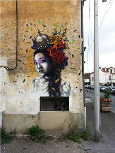 This comes from London resident Fin DAC and was recently paitned in Paris. Its based on a renaissance painting called 'woman with ermine,' which featured a a woman with a host of peculiar animals. Its part of a series that has been altered fromthe roiginal painting, focusing on Asian women. Check out http://findac.tumblr.com/ for more.