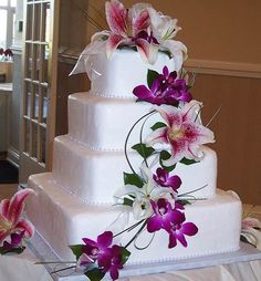 Like this cake with white lilies and blue flowers and ribbon mindynichole