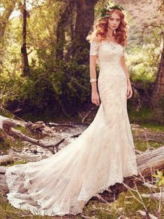 Maggie Sottero - reynold, Lace appliqués cascade down this lightweight fit-and-flare wedding gown, featuring an alluring sweetheart neckline and striking lace hem. Finished with corset closure, or crystal buttons over zipper and inner corset closure. Lace illusion off-the-shoulder jacket with short sleeves sold separately.