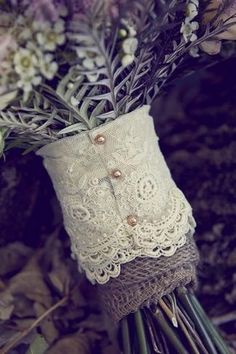 Burlap  Lace pearl buttons--site has lots of inexpensive ideas