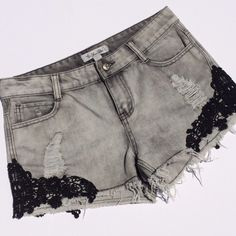 DENIIM AND LACE Black lace adorn the thigh of the awesome distressed and frayed cut offs. Perfect for Summer! Cotton / poly blend (#10 Dimndgrl Shorts Jean Shorts