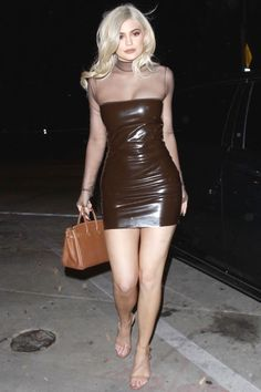 Kylie Jenner goes out to dinner with bf Tyga in Los Angeles on September 22 looking very '90s in this brown mesh-sleeved dress.