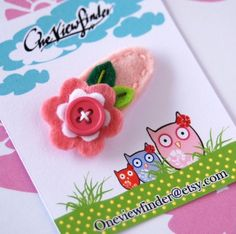 felt button flower hairclip, maybe for Grace?