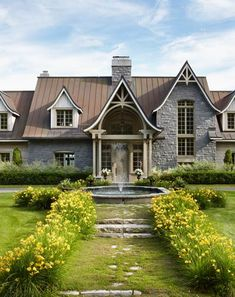YES!!  Exactly the look we are going for.  Gray-tone stone with cream trusses (in this sort of Gothis style)  I love these trusses and the tin roof of this house.