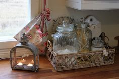 organize kitchen counters with a basket containing glass bottles and jars of your most used oils and spices.