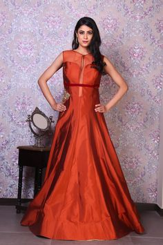 rust is the new nude on the runway and is an exemplary shade for the indian skin tone. Add a hint of quirk and wear the raw silk gown with a pair of tourquise stilettos. #dress #dresses #gown #gowns #shop #shopping #shopdress #buydress #shoppingonline #onlineshop #embroidery #sparkling #eveningdress #partydress #couture #hautecouture #couturedress #design #designer #savetheweavers #saveartisans #India #zarivastram #iwearhandloom #handloomforfashion #handloomfornatio