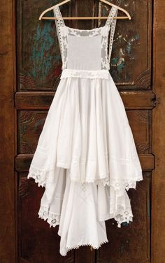 Even the thread on this dress by Rianna Humble is repurposed from upcycled and thrifted items. See how she incorporated vintage laces and linens inside Altered Couture.