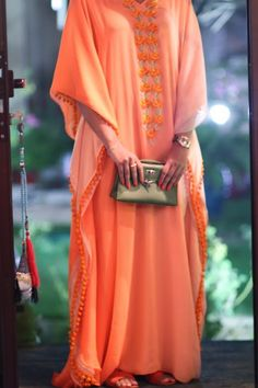 Sunset orange kaftan with a floral embroidered panel. Such a dreamy kaftan for summer!
