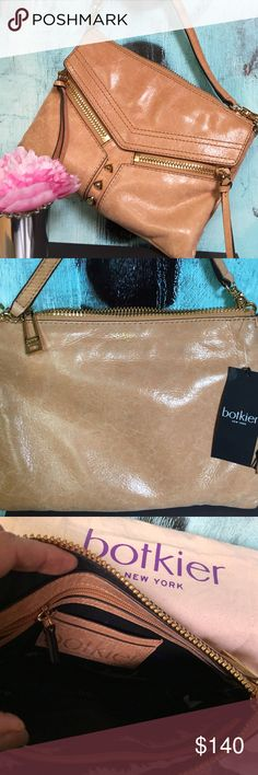 ⚡️Flash Sale⚡️ Botkier Crossbody NWT genuine buttery soft leather camel clutch with adjustable strap to turn it into a crossbody.    Front flaps open with magnetic snap and 2 frontal pockets are functional.  Gold hardware & rich purple lining enhances the total look to this beautiful bag.  ❌Trades. Botkier Bags Crossbody Bags
