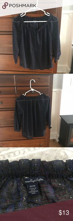 Three quarter sleeve American eagle top XS American Eagle navy blue three quarter sleeve. Smooth silky feel that is see through. Perfect for dressing up or for everyday. American Eagle Outfitters Tops Blouses