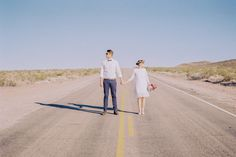 bride and groom in the middle of the deserted road