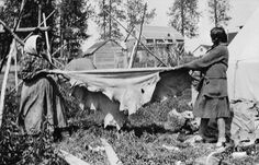 Ojibwa women stretching Moose hide near English River, Ontario - circa 1925