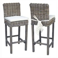 "An island-chic addition to your patio pub table or kitchen counter, this indoor/outdoor barstool features a woven rattan design and gray finish. Product: Indoor/outdoor barstool    Construction Material: Rattan    Color: Gray   Features:  Dipped in hot mud for about 2 weeks to give the driftwood color and enhance its performance against outdoor elements    Suitable for indoor or outdoor useCushions included  Dimensions: 44"" H x 21"" W x 18"" D"