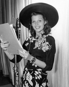"Rita Hayworth: 1940's Radio Hour Costume Idea || Radio Hour Voice (Men & Women) >> before TV, the radio is what everyone used for news and entertainment. Be one of the famous ""voices"" of the radio by dressing in 1940s clothing and caring around an old microphone as a prop. Stop and recite some funny vintage commercials, sing a song, report the news or play a game show. Use real scripts from the 1940s and entertain your friends!"