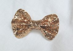 i have to make one of these!  gold sequin hair bow! beautiful!