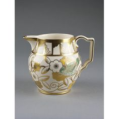 Milk jug  Place of Origin  England, Great Britain (made)  Date  ca. 1925-1930 (made)  Artist/maker  Cooper, Susie, born 1902 - died 1995 (designer)  A. E. Gray & Co. Ltd. (maker)  Materials and Techniques  Glazed earthenware painted and gilded