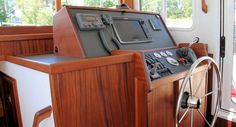 Nordic Tug 34: The helm is uncomplicated and orderly with everything mounted to a non-glare panel mounted in oiled mahogany.