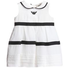 <span>Armani Baby girls beautiful white sleeveless dress made from a lightweight soft silky viscose silk mix trimmed with navy blue piping around the collar and grosgrain ribbon around the dress. It is fully lined in a soft cotton and has a tulle underskirt which gives a full and flared shape and the hem has rows of sweet pleats. The dress is finished with a black diamanté eagle logo and comes with matching bloomers that have an elasticated waist and leg cuffs.<br /></span> <ul> <li>65%…