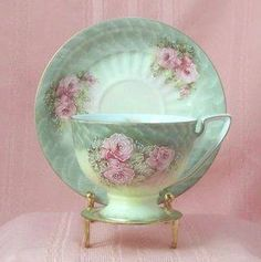 Tea cup/saucer, love the pastel colors.