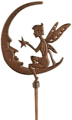 "Gift Craft 48.4-Inch Cast Iron Fairy with Moon Design Garden Stake, Large, Antique Brown by Gift Craft. $39.06. Well suited for planters and plant beds alike. Outdoor safe. Durable cast iron construction. Enchantingly charming best describes the cast iron fairy garden stake. the design features a petite fairy holding a star while sitting on a half moon. measures approximately 7.9"" x 48.4""."