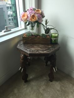 Am loving my new green corner, beautiful succulents in vintage gold, handmade candle in a recycled wine bottle ~ all on a hand carved elephant table my mom brought from India in the 70's!