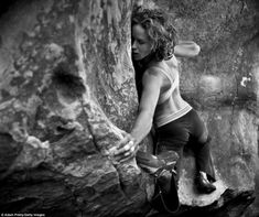 The adventurous Parkins was also photographed climbing the Hollow Mountain Cave at Palm Beach, Australia