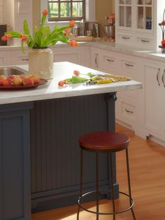 Kitchens are typically found in the back of the house.  When designing a farmhouse space consider beadboard on the walls or kitchen cabinets to create a quaint country essence.