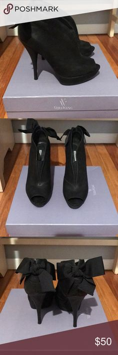 Vera Wang Booties - Comes with dust bag! And box! Vera Wang black Booties Bow in the back  Open slit down the front middle Comes with box  Comes with dust bag Barely worn Vera Wang Shoes Ankle Boots & Booties