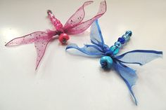 {Beaded Dragonflies} They make them into pins, but I think they'd be adorable as hair barrettes!  So cute.