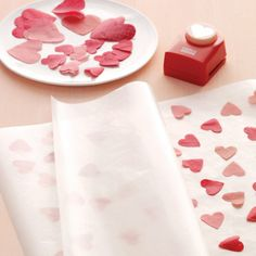 Make gift wrap by fusing wax paper sheets and tissue paper shapes together.