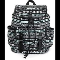 Black/Mint Tribal Backpack This medium size backpack is made with a black and mint tribal print cotton canvas exterior and features ample storage space to keep all your things stored and secure in style. Contrast synthetic leather trim and detailing. Taffeta lined main compartment with interior zip pocket. Cinch and magnetic snap closure for secure storage. Front pouch pocket with dual magnetic snap closures. Open side pockets. Lightly padded adjustable shoulder straps. Top handle for easy…