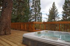 A Breath Of Fresh Air - four bedroom, two bath cabin, large deck with a hot tub, horseshoes and propane barbecue. This cabin also features a full size Arcade Game with all the classics (Pac Man, Donkey Kong, Frogger, etc.), bumper pool/ poker table and foosball table.